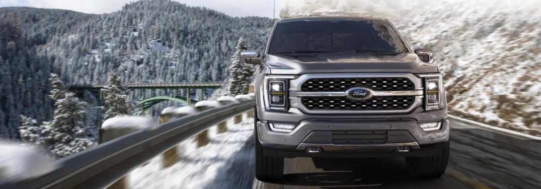 2021 Ford F-150 on mountain pass in snowy landscape