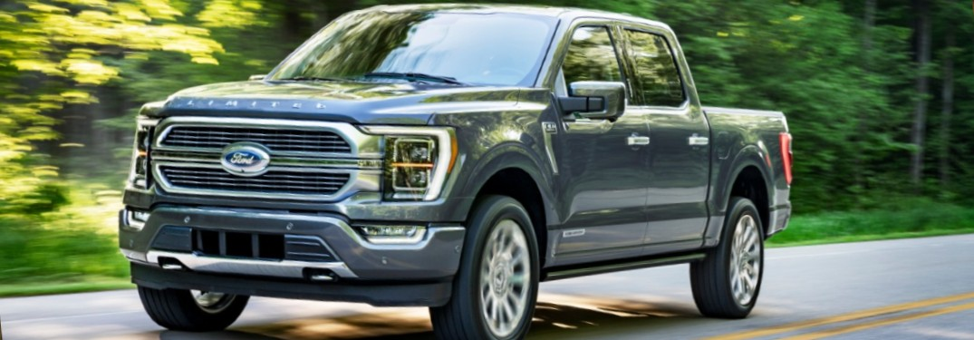 2021 Ford F-150 Hybrid on forest-lined road