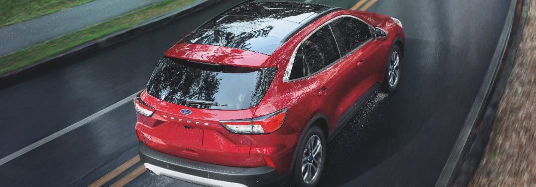2021 Ford Escape on rain-slicked road