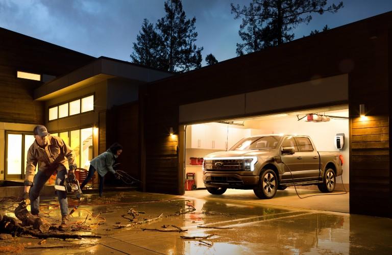 2021 Ford F-150 Lightning in garage at night