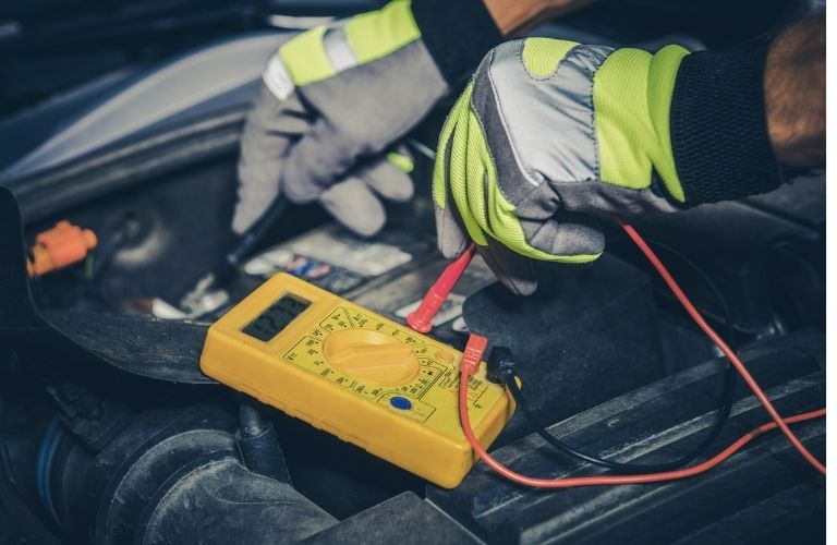 Mechanic checking the car battery