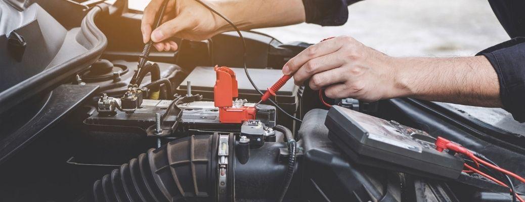 Mechanic working on the car engine.
