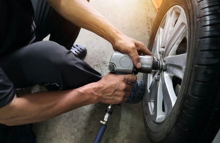 Mechanic aligning car wheels