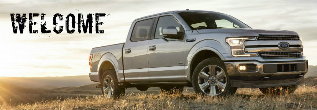 2018 Ford F-150 parked in field with Welcome written beside it