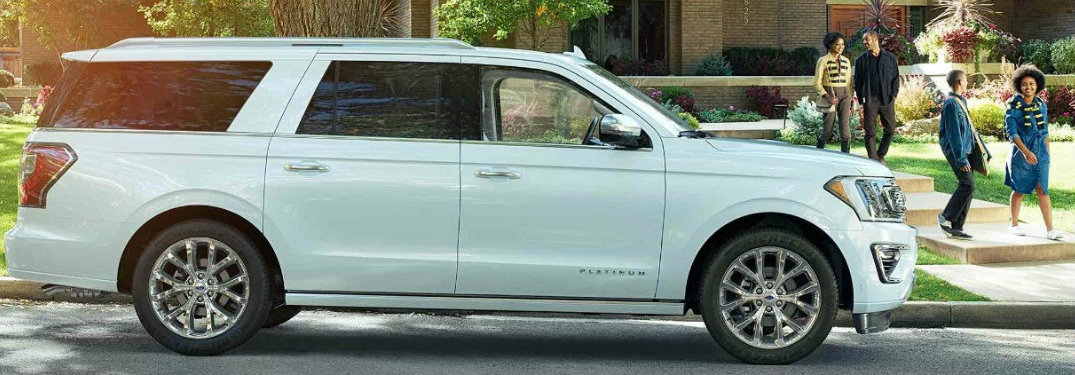 2018 Ford Expedition parked on side of road with family walking toward it