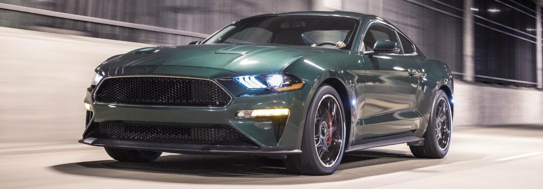 2019 Ford Mustang Bullitt in Dark Highland Green driving down tunnel exterior front quarter view
