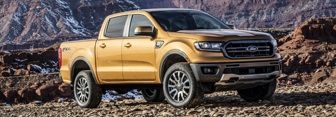 2019 Ford Ranger in front of rocky background exterior front quarter view