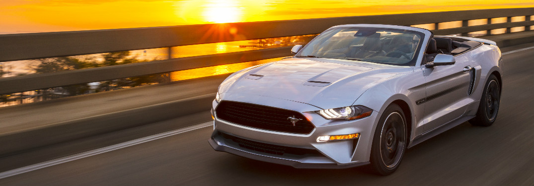 2019 Ford Mustang California Special exterior front driver side view with the coast and sunset behind it