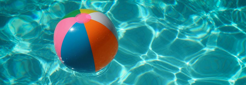 beach ball in pool water
