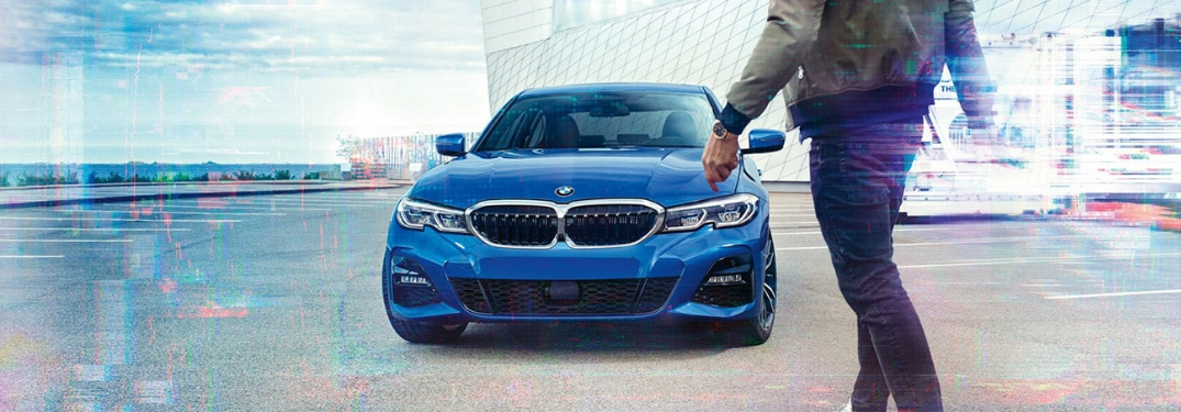 2019 bmw 3 series with man walking
