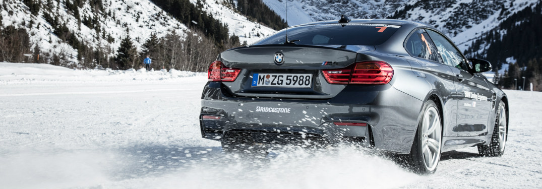 BMW equipped with xDrive cruising through snow