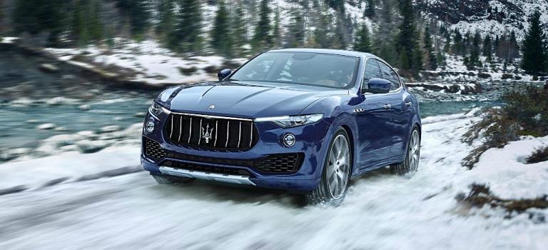2018 Maserati Levante blue front view in snow