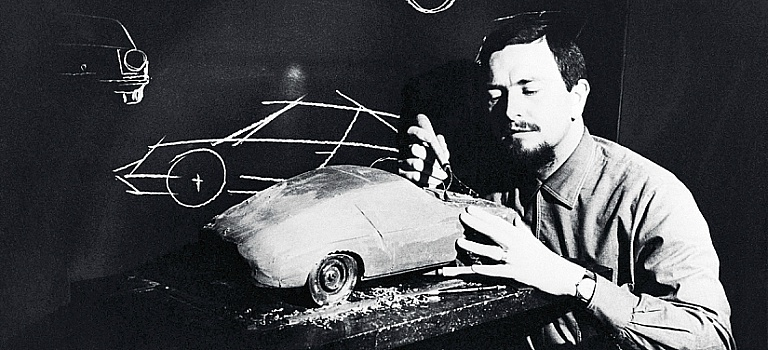 Ferdinand Porsche sculpting a car out of clay