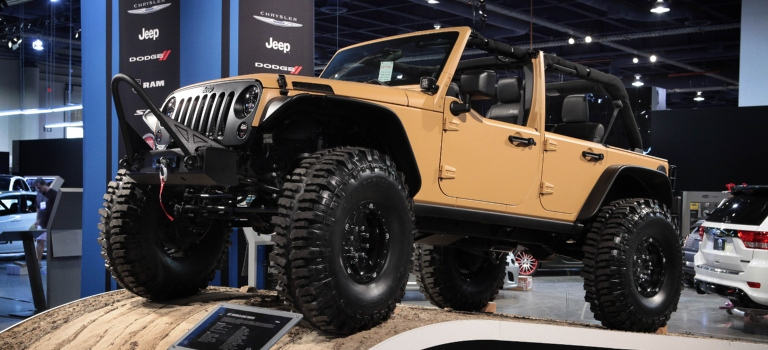 2012 Jeep Wrangler tan lifted side view