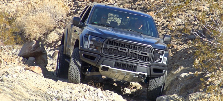 2017 Ford F-150 Raptor blue front view rock crawling