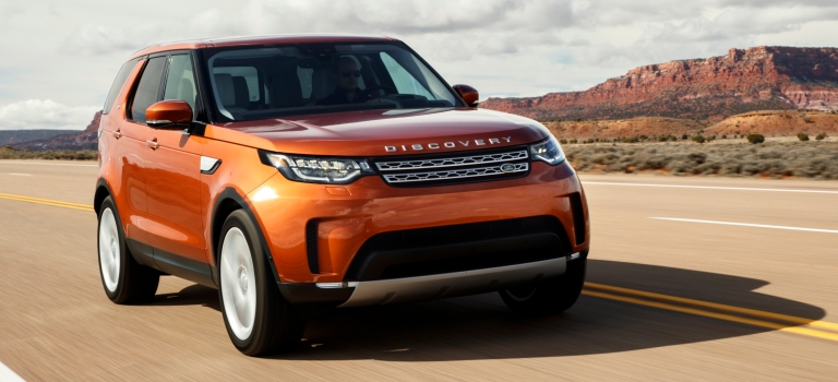 Land Rover Discovery orange front view
