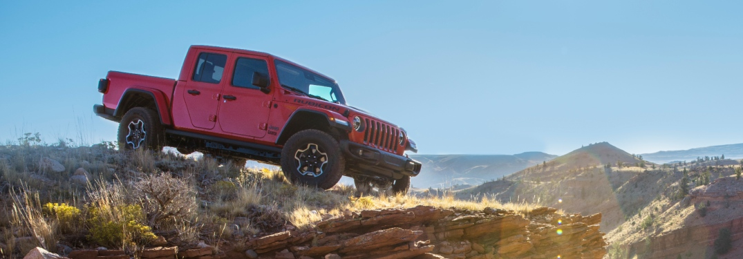 2020 Jeep Gladiator red side view on a cliff