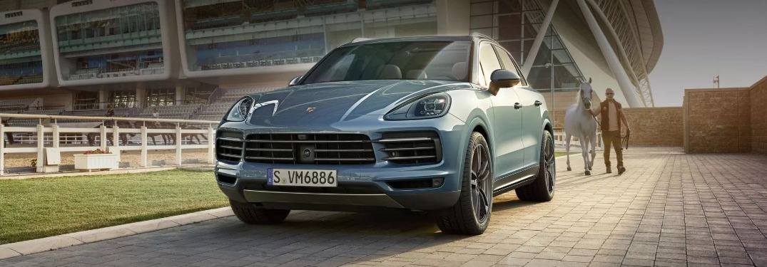 Man walking towards 2019 Porsche Cayenne