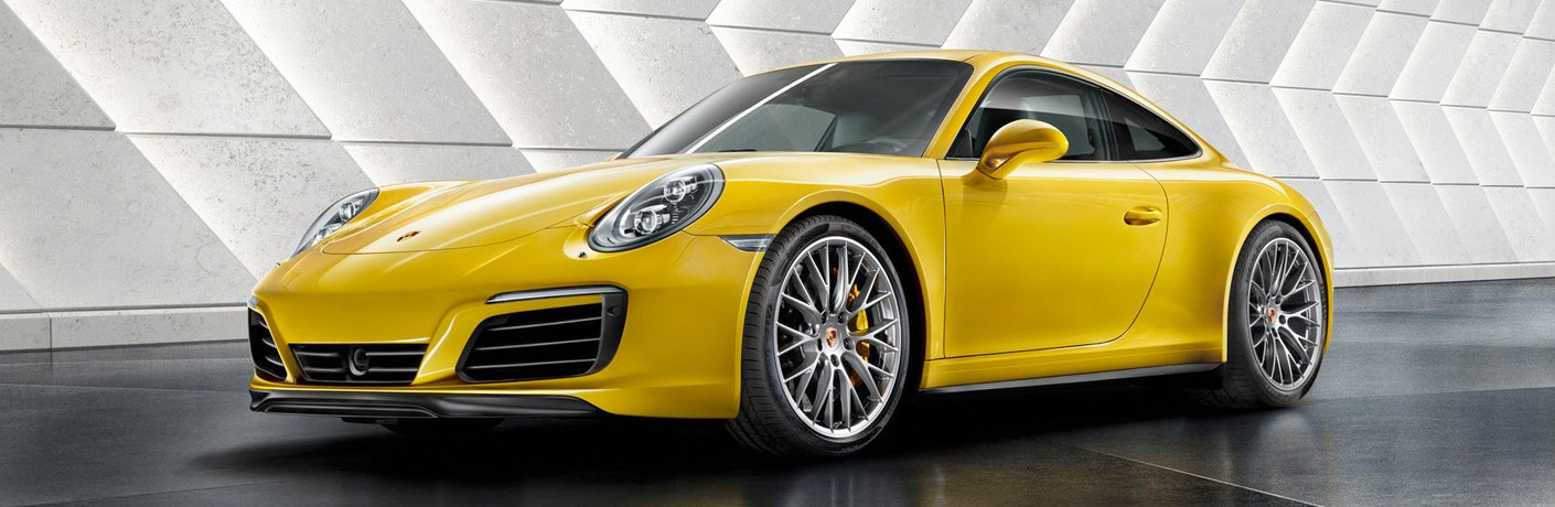 2018 Porsche 911 Carrera yellow side view