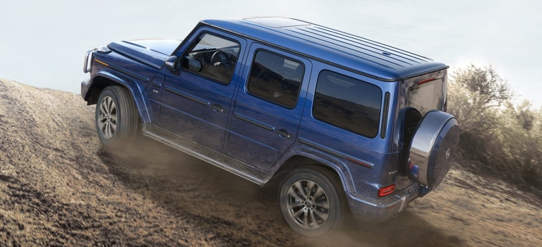 2019 Mercedes-Benz G-Class blue back view climbing a dirt mound