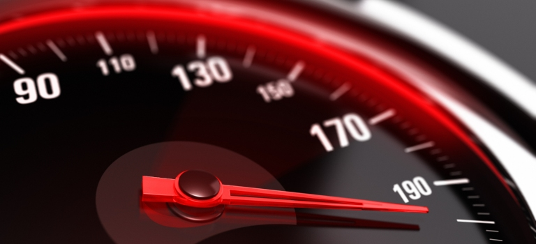 red and black speedometer pushing beyond 190 mph