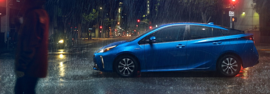 2019 Toytoa Prius blue side view in the rain