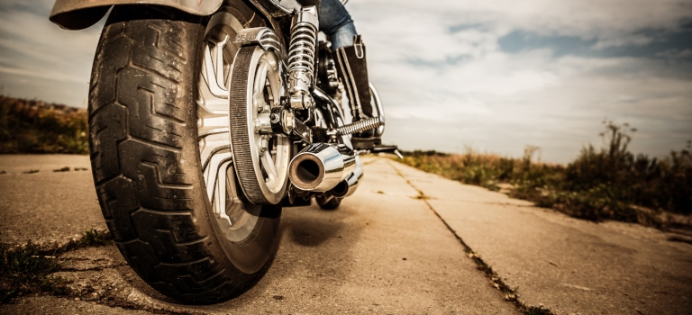 Motorcycle back wheel on an open road