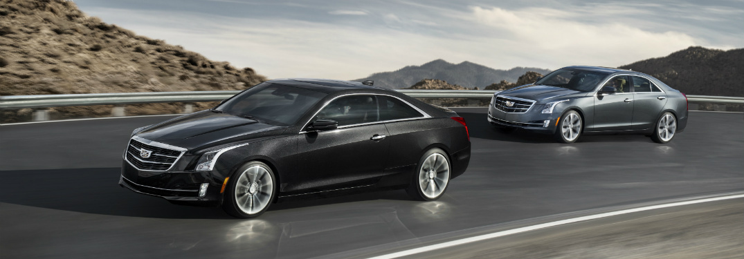 black and silver 2018 cadillac ats driving on highway