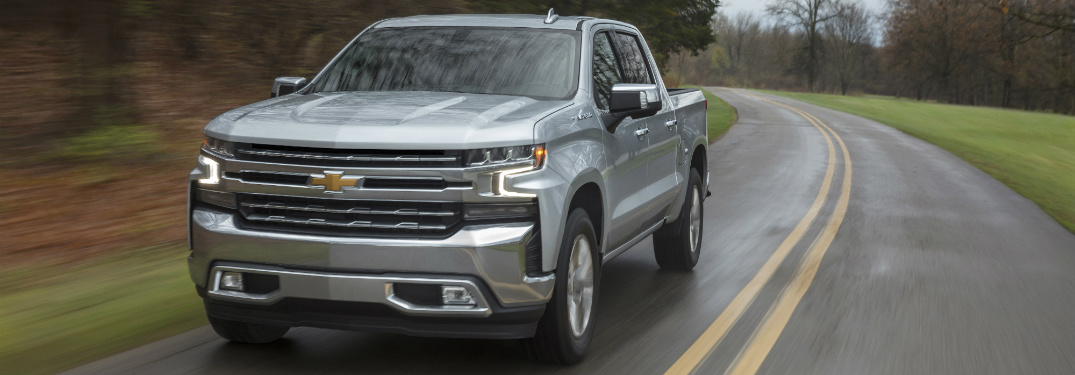 front and side view of silver 2019 chevrolet silverado on empty road