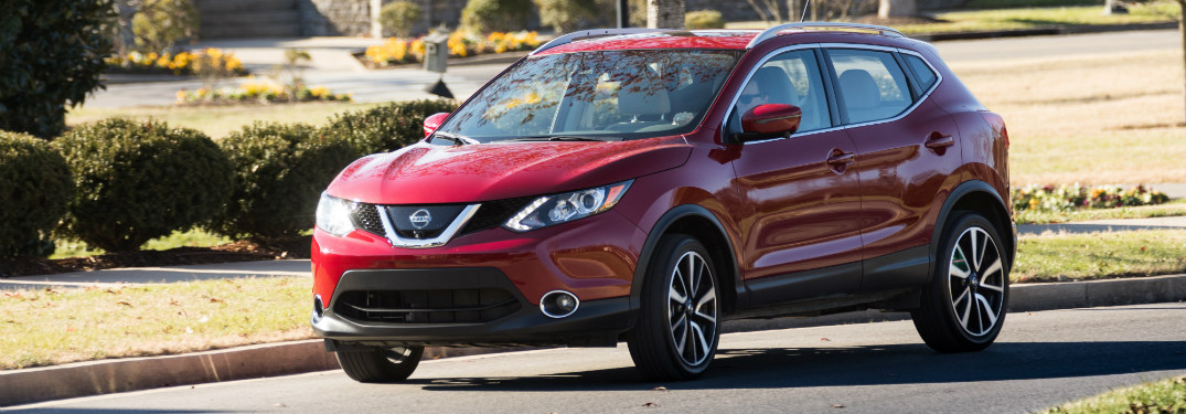 front and side view of red 2018 nissan rogue sport