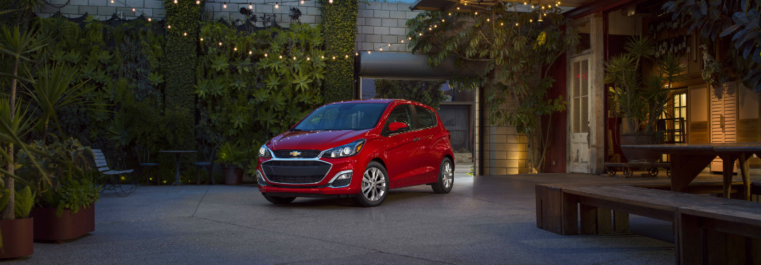 front and side view of red 2019 chevrolet spark