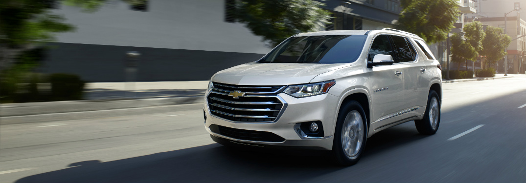 front and side view of white 2019 chevrolet traverse