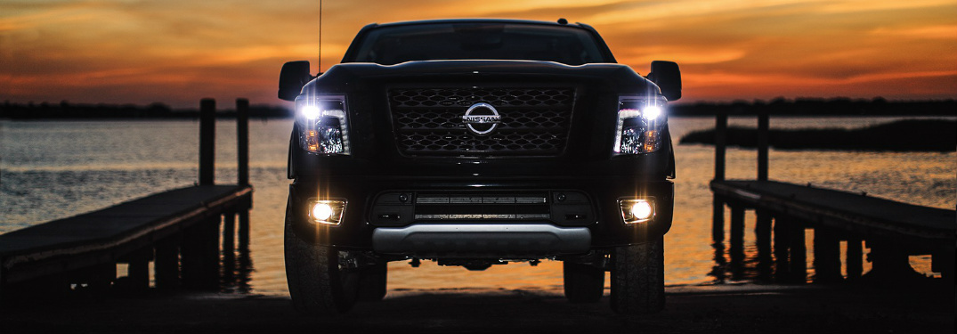 front view of black 2018 nissan titan at night