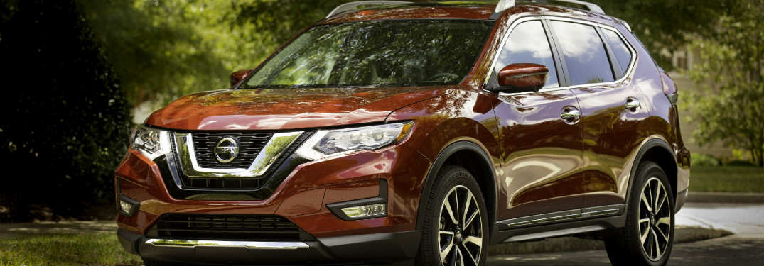 front and side view of red 2019 nissan rogue
