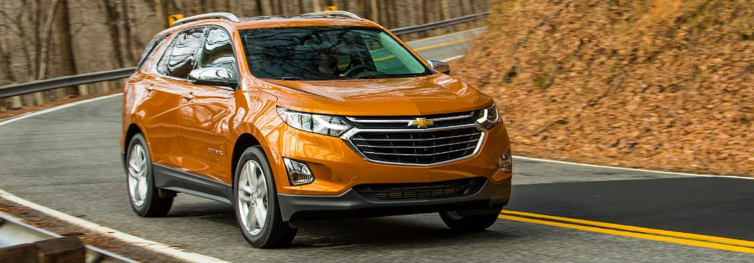 front and side view of orange 2019 chevy equinox
