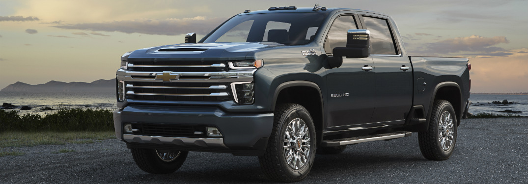 front and side view of blue 2020 chevy silverado hd high country