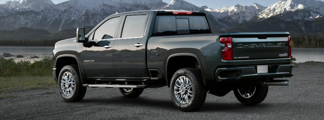 rear and side view of blue 2020 chevy silverado hd high country