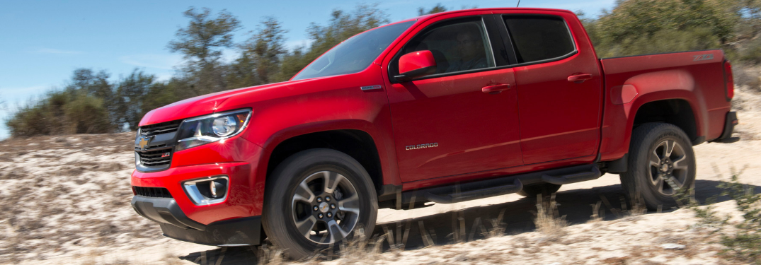 side view of red 2019 chevy colorado