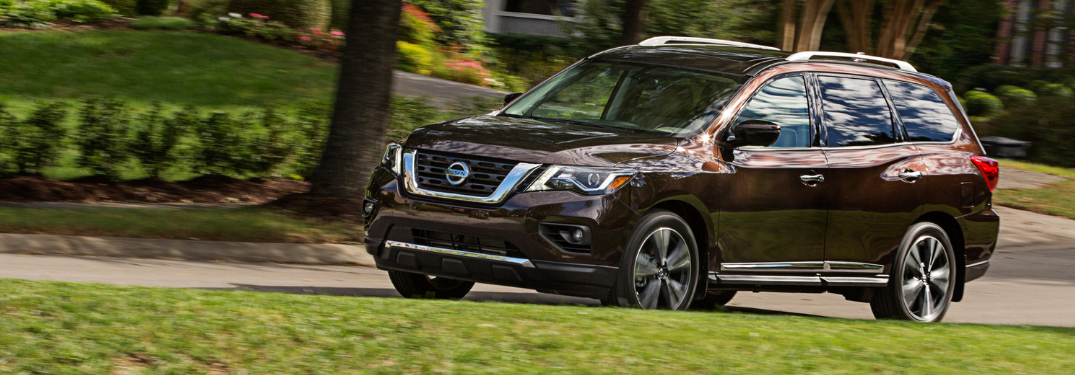 front and side view of red 2019 nissan pathfinder