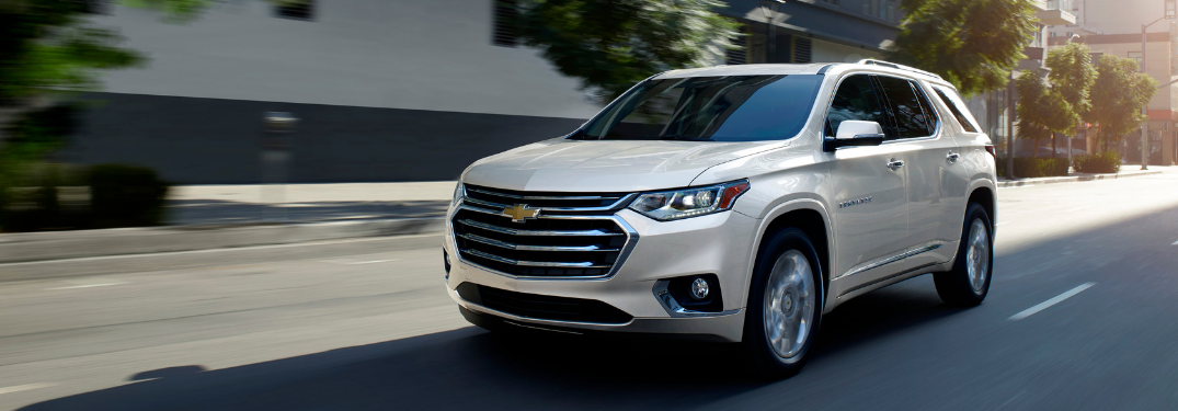 front and side view of white 2019 chevy traverse
