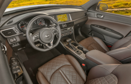 front interior of 2018 kia optima including steering wheel and infotainment interface