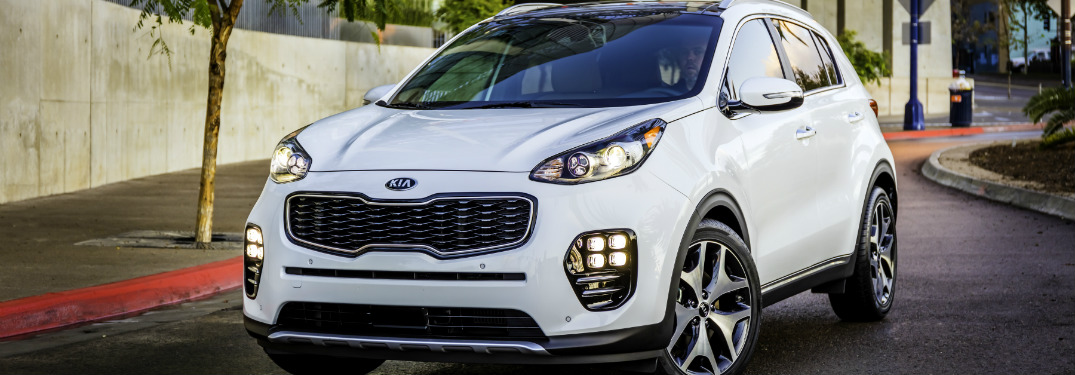 front and side view of white 2019 kia sportage