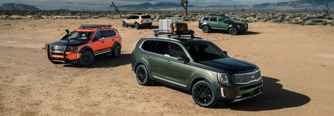 Four 2020 Kia Telluride models parked in desert area
