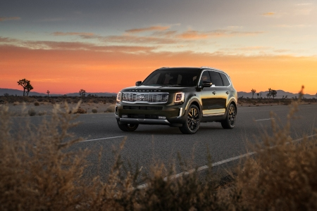 2020 Kia Telluride driving in desert at sunset