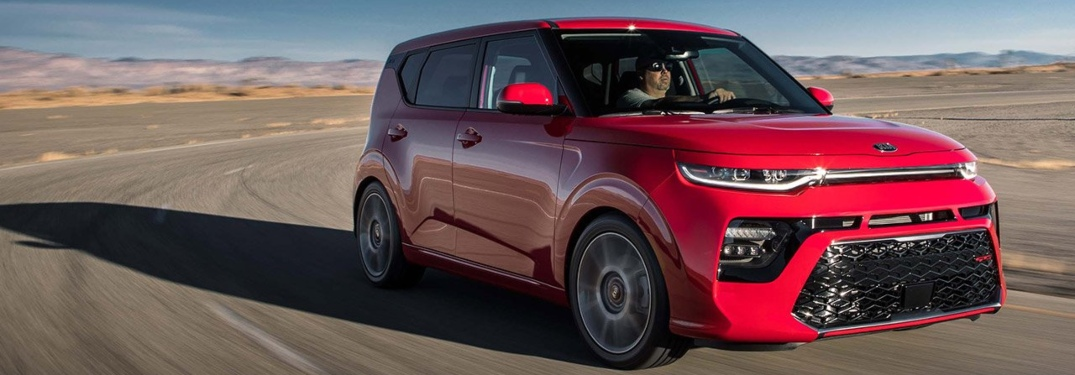 Man behind the wheel of a red 2020 Kia Soul