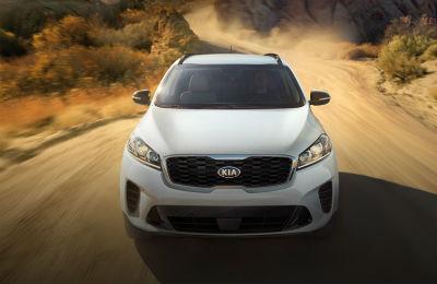 2020 Kia Sorento white exterior front fascia driving on desert dirt road