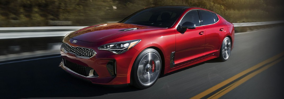 2020 Kia Stinger red exterior front driver side driving