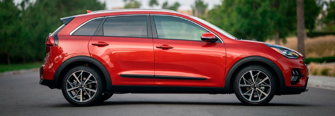 2020 Kia Niro red exterior passenger side parked in middle of road