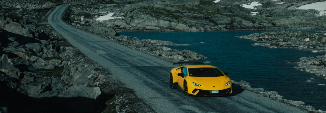 Lamborghini Aventador yellow front view in the country