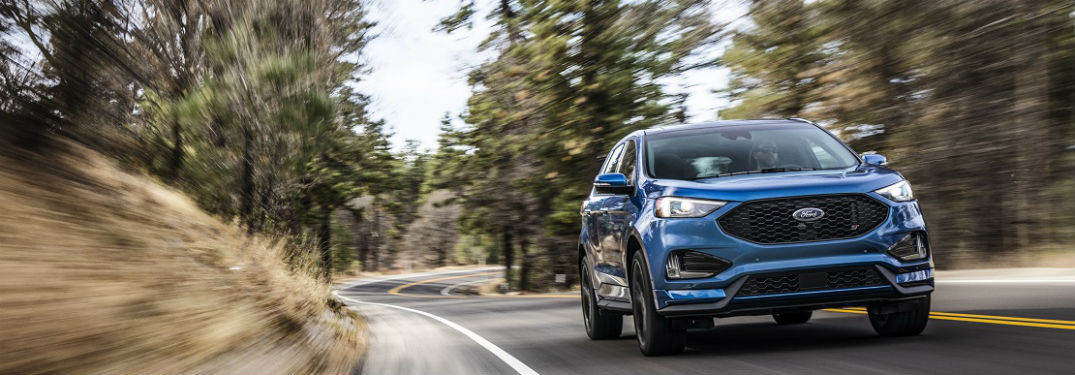 Ford Edge St In Blue Driving On Forest Road